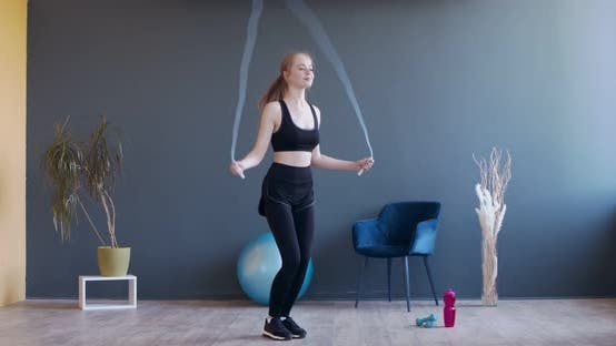 Thumbnail for Young Sporty Woman Exercising with Skipping Rope