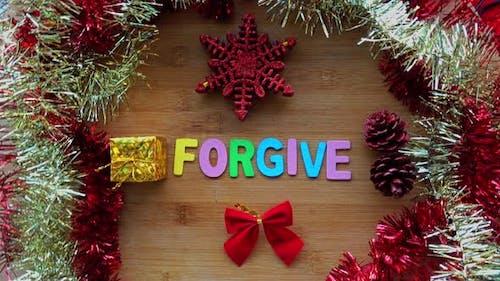 Vergib Wort mit Weihnachtsdekoration