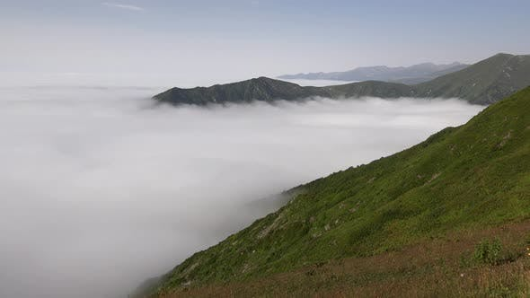 Sea of Clouds Movements in High Altitude Tundra Mountain Climate