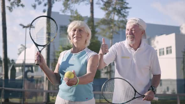 Thumbnail for Portrait Happy Adult Couple Playing Tennis on a Sunny Day