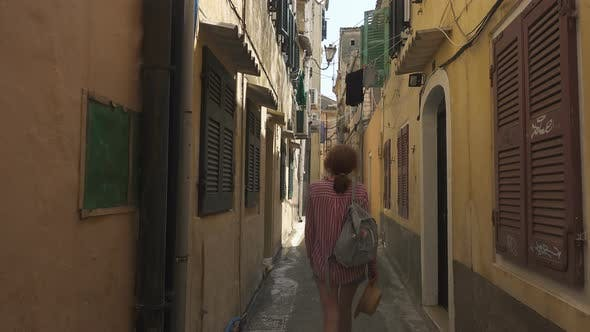 Tourist Woman Walking By The Streets Of Old City Of Kerkyra 2