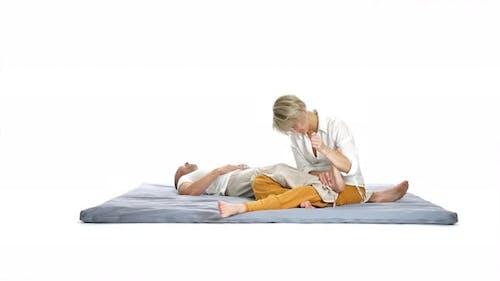 Foot Massage on Floor Isolated on White