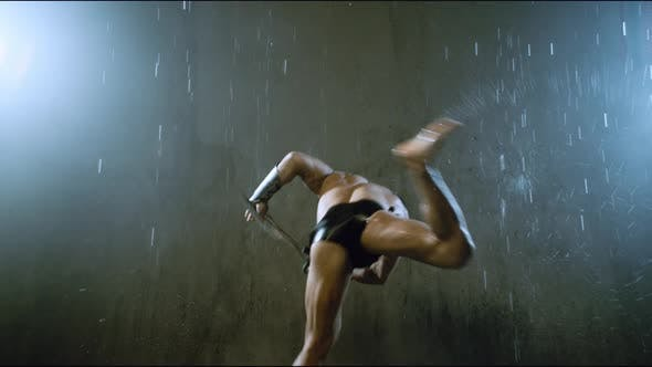 Thumbnail for Wet Spartan Jumping Around in Attack Under Rain.