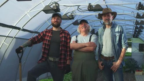 Cheerful Multi Generational Farmers in Hothouse
