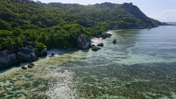 Thumbnail for Aerial Footage Fly Along Famous Anse Source d'Argent Tropical Beach with Unique Granite Boulders