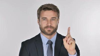 Portrait of Businessman Waving Finger To Refuse