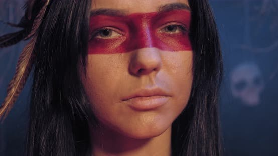 Thumbnail for Beautiful Native American Woman with Red Traditional Paint on Her Face, Portrait