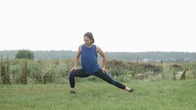 Woman stretching outdoor before running