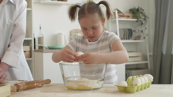 Thumbnail for Woman and Girl with Down Syndrome Making Pie