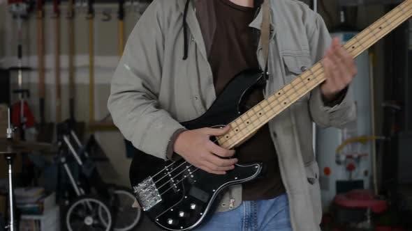 Portrait of garage band guitar player