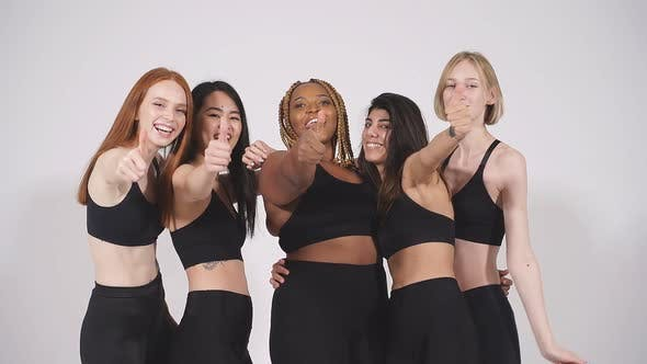 Optimistic Diverse Models Showing Thumbs Up