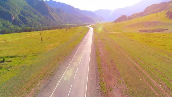 Thumbnail for Flight Over Mountain Asphalt Highway Road and Meadow