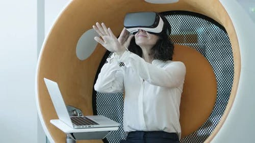 Woman with Laptop Using Vr Headset