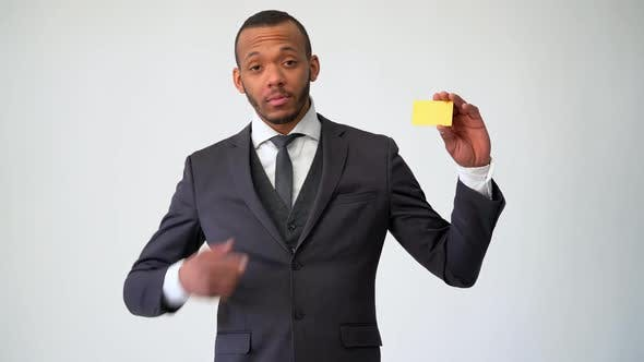 African-american Businessman Holding Credit or Debit Bank Card