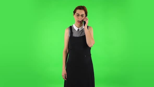 Thumbnail for Funny Girl in Round Glasses Is Angrily Talking for Mobile Phone, Proving Something. Green Screen