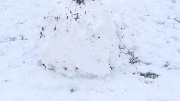 Child Make a Snow Ball