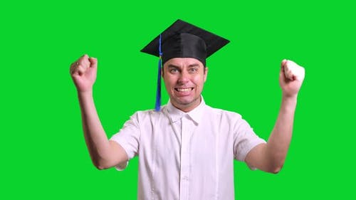 Young Male Smiling Graduate College in Black Graduating Hat