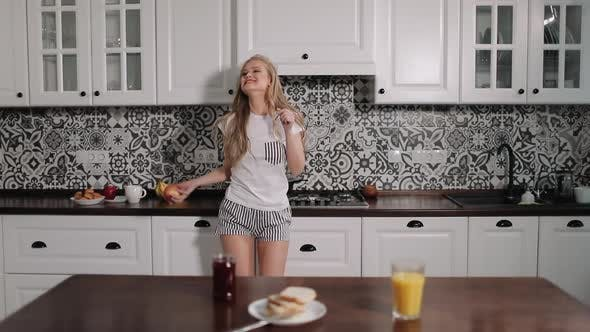 Thumbnail for Happy Girl Dancing in Kitchen