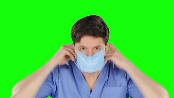 Thumbnail for Doctor Puts on Protetcive Mask, Green Screen