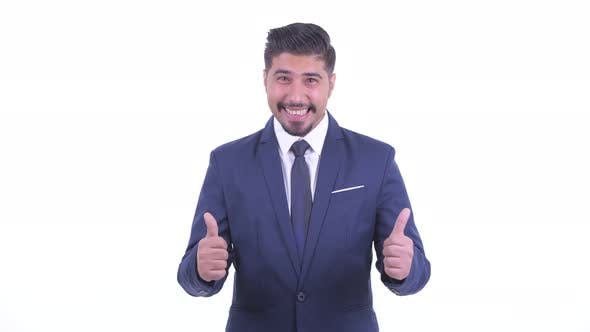 Happy Bearded Persian Businessman Giving Thumbs Up and Looking Excited