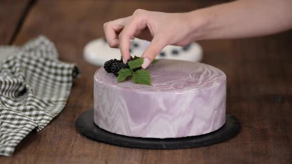 Thumbnail for Women's Hands Decorate a Berry Mousse Cake with with Fresh Berries on the Kitchen Table.