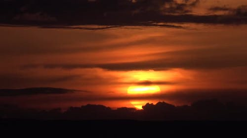 Sunset Over Horizontal Dark Cloud Layers