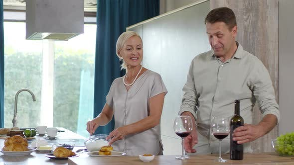 Thumbnail for Happy Caucasian Couple Cooking and Drinking Wine at Home
