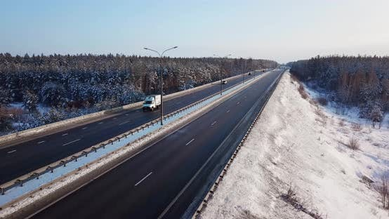 Thumbnail for Aerial View of a Highway Road with Traffic Cars and Trucks on the Road in Winter