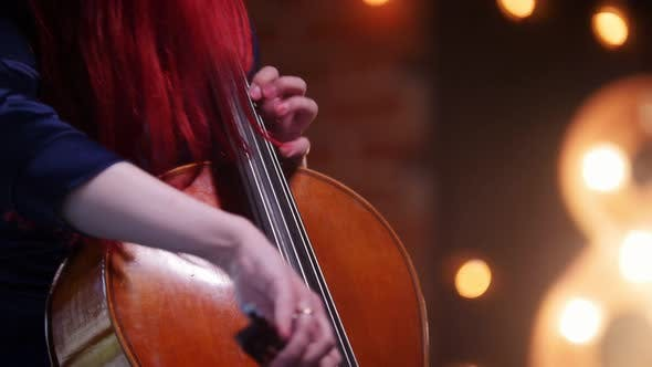 Thumbnail for A Woman with Colorful Hair Playing the Cello in the Studio