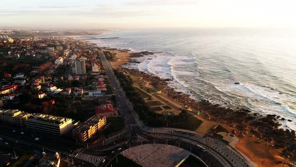 Thumbnail for Aerial View of Town Seafront with Empty Beach and Cars Driving on Road, Portugal