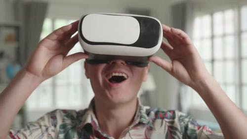 Asian Man Explores Virtual Reality In Living Room