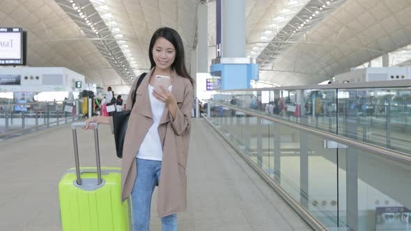 Thumbnail for Woman working on cellphone in Hong Kong international airport