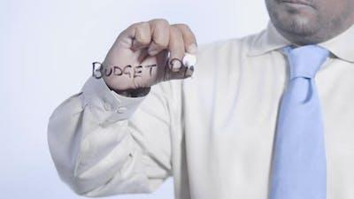 Asian Businessman Writes Budget Plan
