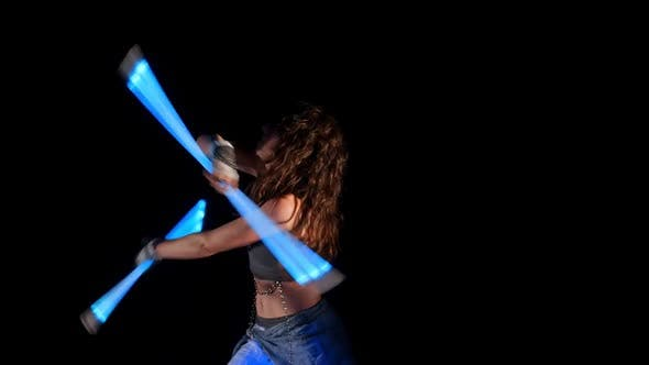 Thumbnail for Beautiful Woman Dance With Neon Staffs In Ultraviolet Light 10