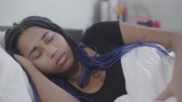 Thumbnail for Close-up Face of African American Girl Sleeping and Fixing White Blanket, Teenager with Dreadlocks