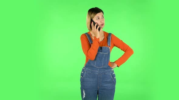 Thumbnail for Girl Angrily Speaks on the Phone, Proves Something. Green Screen