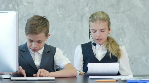 Thumbnail for Two Cute Children in Business Clothing in Business Center Working with Documents and Computer