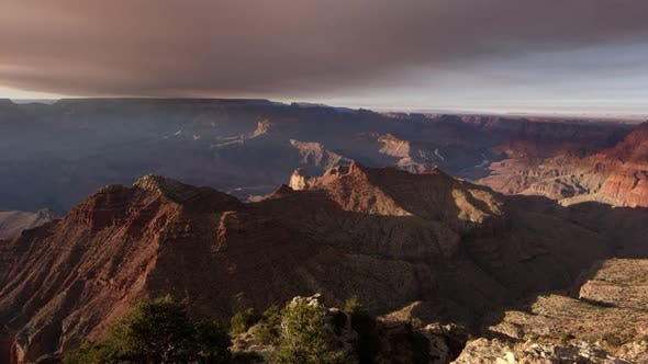 Thumbnail for Panning view of cliffs lit up from the South Rim of the Grand Canyon