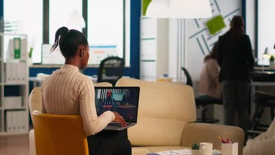 Black Woman Discussing with Remote Disabled Colleague Using Video Call