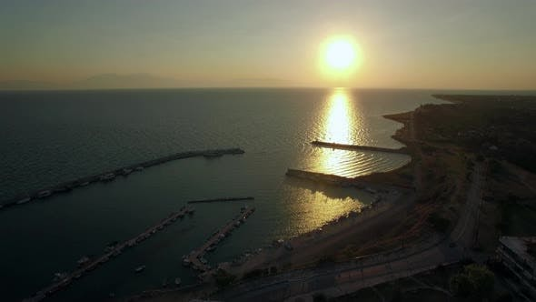 Thumbnail for Flying Over the Sea and Quay at Sunrise, Greece