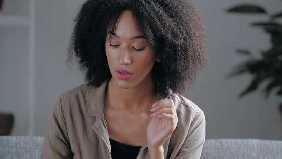 Thumbnail for Close Up African Ethnicity Pensive Young Woman Sit on Couch Alone Waits Feels Jealousy. Sad Female