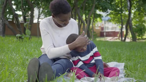 Thumbnail for Portrait Attractive African American Woman Sitting on the Blanket with Her Little Son