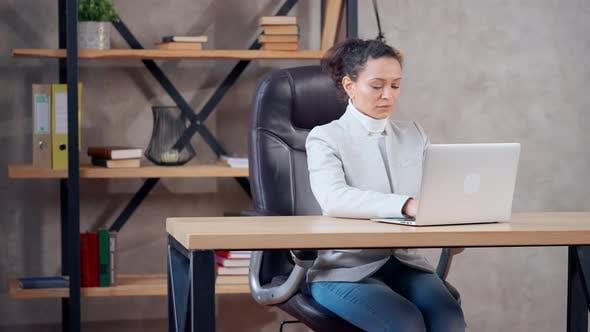 Adult Businesswoman Using Computer