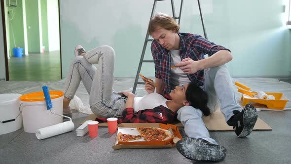 Thumbnail for Happy Diy Couple Relaxing After Painting a Room