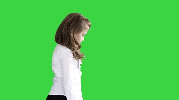 Thumbnail for Little Girl with Long Hair Walking and Looking Down on a Green Screen, Chroma Key