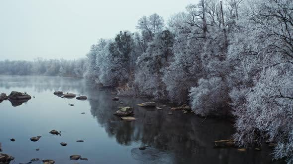 Thumbnail for Shallow River near Winter Forest