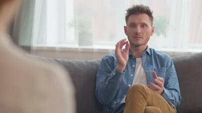 Man Talking on Therapy Session