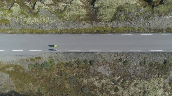 Thumbnail for Cyclists in Helmets Are Racing on Mountain Road in Norway in Summer