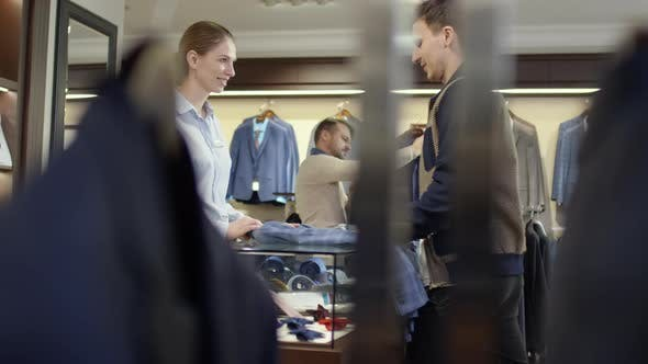 Thumbnail for Female Sales Assistant Advising and Serving Customers