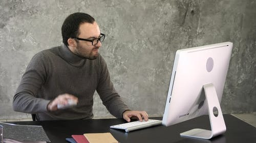 Entrepreneur angry and furious at computer. Reaction to